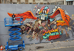 © Licensed to London News Pictures. 16/08/2012. Bristol, UK. Artists Flying Fortress and Nychos near completion of a new piece of art in the See No Evil 2012 street art event, with artists from around the world creating new work on buildings in Nelson Street, Bristol.  It will be the biggest permanent street art installation in Europe.  The project runs till 19 August, with a Block Party on 18 August. 16 August 2012..Photo credit: Simon Chapman/LNP