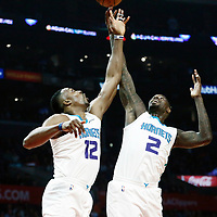 31 December 2017: Charlotte Hornets center Dwight Howard (12) vies for the rebound with Charlotte Hornets forward Marvin Williams (2) during the LA Clippers 106-98 victory over the Charlotte Hornets, at the Staples Center, Los Angeles, California, USA.