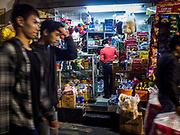 25 DECEMBER 2017 - HANOI, VIETNAM: People walk past a small convenience stand in the Old Quarter of Hanoi.      PHOTO BY JACK KURTZ
