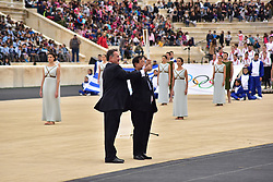 October 31, 2017 - Athens, Attiki, Greece - President of the Hellenic Olympic Committee Spyros Capralos (left) is handover the Tourch with the Olympic Flame to the President of the Organising Committee for the XXIII Winter Olympics Games 'PYEONGCHANG 2018' Lee Hee Beom (right). The Handover Ceremony of the Olympic Flame for Winter Games PYEONGCHANG 2018, took place today in Panathenaic Stadium in the presence of the President of Hellenic Republic Prokopis Pavlopoulos. (Credit Image: © Dimitrios Karvountzis/Pacific Press via ZUMA Wire)