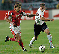 Fotball<br /> VM-kvalifisering<br /> 03.09.2005<br /> Polen v Østerrike<br /> Foto: Wrofoto/Digitalsport<br /> NORWAY ONLY<br /> <br /> Andreas Ivanschitz (L) from Austria challenges for the ball with Marcin Baszczynski from Poland