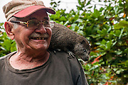 Topes de Collantes nature reserve, Escambray Mountains, Cuba. Local farmer with his pet water rat