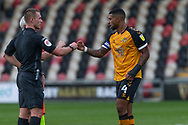 Newport County's Captain Joss Labadie (4) fist bumps Referee Thomas Bramall after the EFL Sky Bet League 2 match between Newport County and Tranmere Rovers at Rodney Parade, Newport, Wales on 17 October 2020.