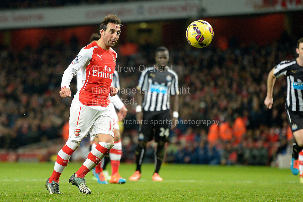 Santi Cazorla of Arsenal scores his teams fourth goal from a Penalty to make it 4-1. Barclays Premier league match, Arsenal v Newcastle Utd at the Emirates Stadium in London on Saturday 13th December 2014.<br /> pic by John Patrick Fletcher, Andrew Orchard sports photography.