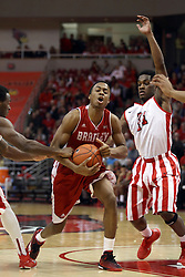 17 January 2015:   Warren Jones gets fouled while attempting to get between Daishon Knight and Paris Lee during an NCAA MVC (Missouri Valley Conference men's basketball game between the Bradley Braves and the Illinois State Redbirds at Redbird Arena in Normal Illinois