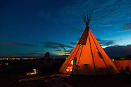 The Cherry Wood Bed, Breakfast and Barn features luxury teepees and horse rides.  The Lone Star tee pee at night.