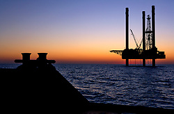 Stock photo of a jack-up rig as seen off of the stern of a pilot boat