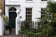 Front door of a house in Islington, London. Showing various eras of architecture. Londoner's homes.