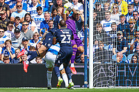 Football - 2021/2022  Sky Bet EFL Championship - Queens Park Rangers vs Millwall - Kiyan Prince Foundation Stadium - Saturday 7th August 2021.<br /> <br /> Seny Dieng (Queens Park Rangers) comes under pressure from Shaun Hutchinson (Millwall FC) as he collects the ball <br /> <br /> COLORSPORT/DANIEL BEARHAM