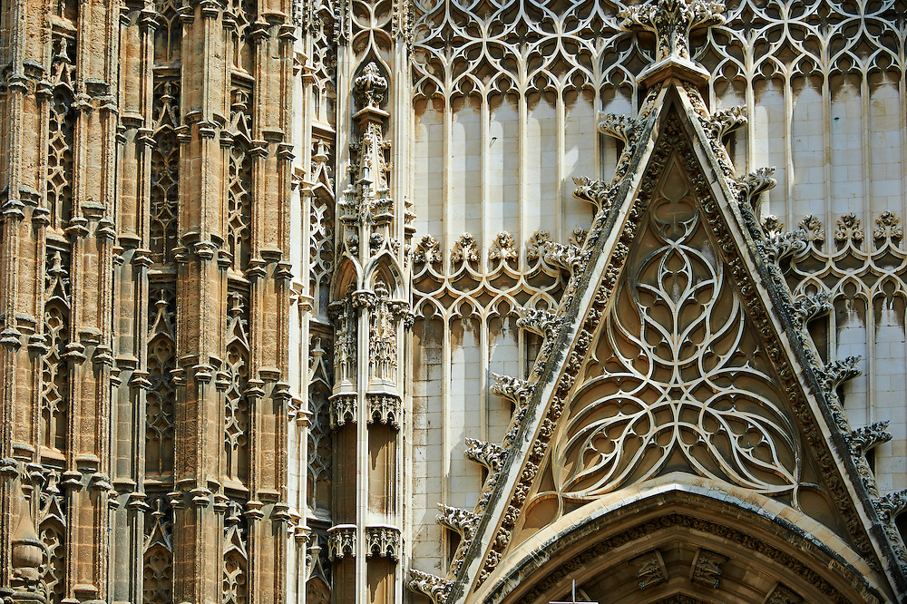 Gothic architectural detail of the Door of the Prince, Seville Cathedral, Spain . The Royal Alcázars of Seville (al-Qasr al-Muriq ) or Alcázar of Seville, is a royal palace in Seville, Spain. It was built by Castilian Christians on the site of an Abbadid Muslim alcazar, or residential fortress.The fortress was destroyed after the Christian conquest of Seville The palace is a preeminent example of Mudéjar architecture in the Iberian Peninsula but features Gothic, Renaissance and Romanesque design elements from previous stages of construction. The upper storeys of the Alcázar are still occupied by the royal family when they are in Seville. <br /> <br /> Visit our SPAIN HISTORIC PLACES PHOTO COLLECTIONS for more photos to download or buy as wall art prints https://funkystock.photoshelter.com/gallery-collection/Pictures-Images-of-Spain-Spanish-Historical-Archaeology-Sites-Museum-Antiquities/C0000EUVhLC3Nbgw <br /> .<br /> Visit our MEDIEVAL PHOTO COLLECTIONS for more   photos  to download or buy as prints https://funkystock.photoshelter.com/gallery-collection/Medieval-Middle-Ages-Historic-Places-Arcaeological-Sites-Pictures-Images-of/C0000B5ZA54_WD0s