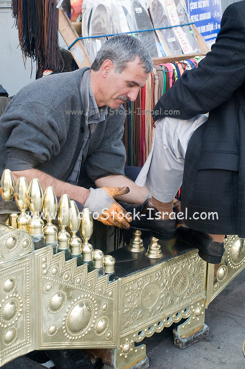 Turkey, Istanbul, Shoeshine stand male client having his shoes polished
