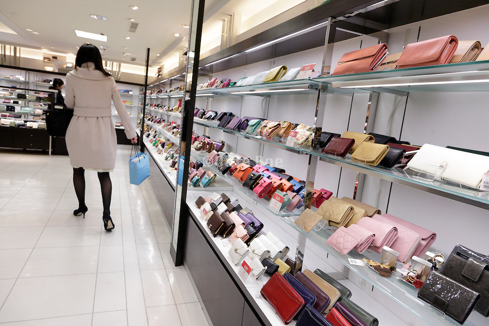 young female adult shopping in a luxury items store
