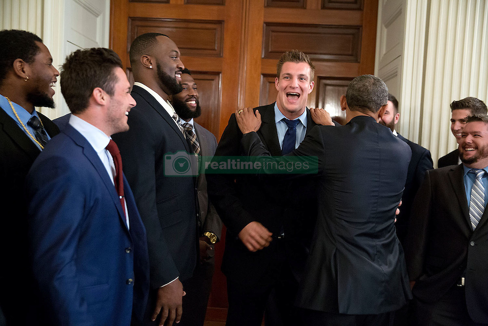 President Barack Obama jokes with tight end Rob Gronkowski, as he greets the New England Patriots in the State Dining Room, prior to an event to honor the team and their Super Bowl XLIX victory, at the White House, April 23, 2015. (Official White House Photo by Pete Souza)<br /> <br /> This official White House photograph is being made available only for publication by news organizations and/or for personal use printing by the subject(s) of the photograph. The photograph may not be manipulated in any way and may not be used in commercial or political materials, advertisements, emails, products, promotions that in any way suggests approval or endorsement of the President, the First Family, or the White House.