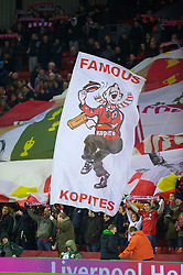 LIVERPOOL, ENGLAND - Wednesday, December 15, 2010: A Liverpool supporter on the Spion Kop waves his flag during the UEFA Europa League Group K match against FC Utrecht at Anfield. Fans on the Kop are known as Kopites. (Photo by: David Rawcliffe/Propaganda)