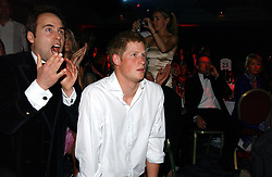Right HRH PRINCE HARRY at the Boodles Boxing Ball in aid of the sports charity Sparks  organised by Jez lawson, James Amos and Charlie Gilkes held at The Royal Lancaster Hotel, Lancaster Terrae London W2 on 3rd June 2006.<br /> <br /> NON EXCLUSIVE - WORLD RIGHTS