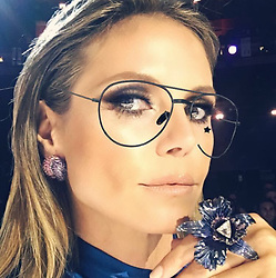 """Heidi Klum releases a photo on Instagram with the following caption: """"Can we just STOP and take a look at my @lorraineschwartz ring \ud83d\ude33"""". Photo Credit: Instagram *** No USA Distribution *** For Editorial Use Only *** Not to be Published in Books or Photo Books ***  Please note: Fees charged by the agency are for the agency's services only, and do not, nor are they intended to, convey to the user any ownership of Copyright or License in the material. The agency does not claim any ownership including but not limited to Copyright or License in the attached material. By publishing this material you expressly agree to indemnify and to hold the agency and its directors, shareholders and employees harmless from any loss, claims, damages, demands, expenses (including legal fees), or any causes of action or allegation against the agency arising out of or connected in any way with publication of the material."""