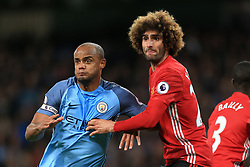 27th April 2017 - Premier League - Manchester City v Manchester United - Vincent Kompany of Man City tussles with Marouane Fellaini of Man Utd - Photo: Simon Stacpoole / Offside.