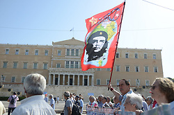 October 3, 2016 - Athens, Greece - Demonstrator holds a big flag with the image of Che Guevarra in front of the Greek Parliament..Greek pensioners demonstrate in Athens against the goverment cuts on pensions and their benefits in General. Demonstrators clashed with riot policve after they found the road to Prime Ministers office closed by police. (Credit Image: © George Panagakis/Pacific Press via ZUMA Wire)