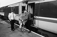 Murray Sayle, Australian journalist, disembarking his Moulton bike to attend the 30th anniversary of Moulton Bikes in the presence of sir Alex Moulton. September 1992 30th anniversary of Moulton Bikes in the presence of Dr Alexander Moulton CBE. September 1992