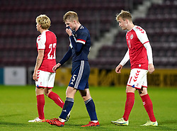 Scotland's Stephen Welsh (centre) reacts after the UEFA Under-21 Championship Qualifying Round Group I match at Tynecastle Park, Edinburgh. Picture date: Thursday, October 7, 2021.