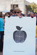 Virgil Scott, a professor of Visual Communications at Texas AM in Commerce Texas holds a sign in solidarity with the students who organized the March for Our Lives event in front of Dallas City  hall in downtown Dallas.