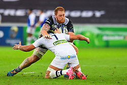 Ospreys' Dan Baker is tackled by Clermont Auvergne's Alexandre Lapandry - Mandatory by-line: Craig Thomas/JMP - 15/10/2017 - RUGBY - Liberty Stadium - Swansea, Wales - Ospreys Rugby v Clermont Auvergne - European Rugby Champions Cup