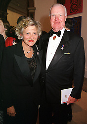 MRS VIVIEN DUFFIELD the multi millionare art patron <br /> and SIR JOCELYN STEVENS, at a dinner in London<br />  on 23rd May 2000.OEL 93