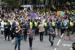 London, June 24th 2017. Anti-fascist protesters counter demonstrate against a march to Parliament by the far right anti-Islamist English Defence League. PICTURED: The EDL contingent numbering less than 100 marches towards their allocated position on Victoria Embankment under heavy police supervision.