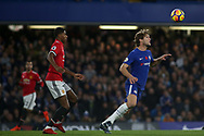 Marcos Alonso of Chelsea heads the ball away from Marcus Rashford of Manchester United . Premier league match, Chelsea v Manchester United at Stamford Bridge in London on Sunday 5th November 2017.<br /> pic by Kieran Clarke, Andrew Orchard sports photography.