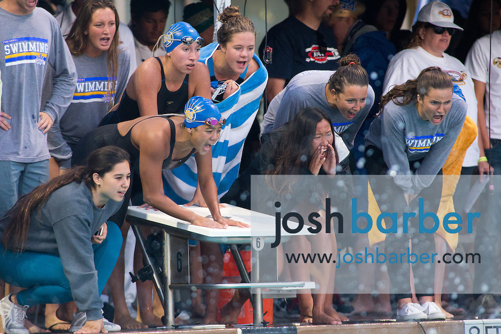 Fountain Valley swimmers cheer for their team in the girls 400-yard freestyle relay consolation during the CIF-SS Division 1 Swimming Finals at Riverside City College on Saturday.