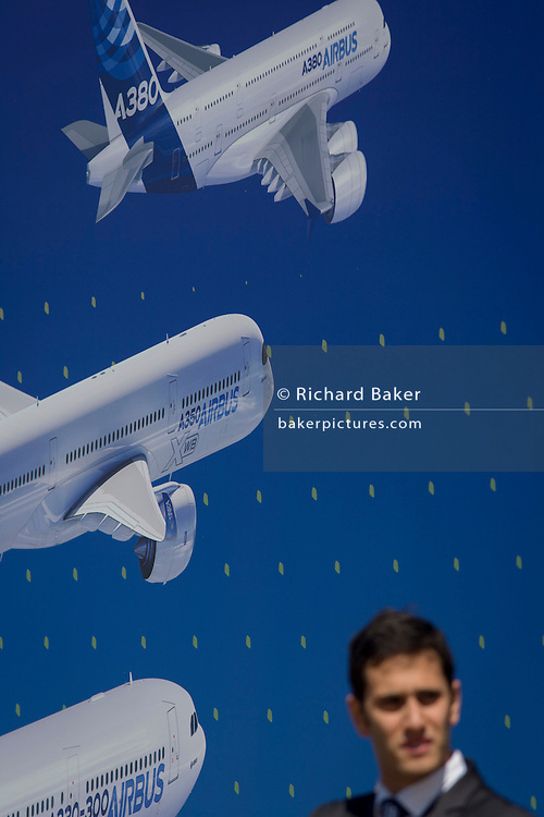 A visitor beneath a billboard of examples of the Airbus airliner fleet on the side of the Airbus corporate chalet at the Farnborough Air Show, England. Airbus is an aircraft manufacturing division of Airbus Group (formerly European Aeronautic Defence and Space Company). Based in Blagnac, France, a suburb of Toulouse, with production and manufacturing facilities mainly in France, Germany, Spain and the United Kingdom, the company produced 626 airliners in 2013.