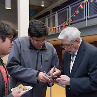 Students Isaiah James, 16, left, and Adrian Bosco, 16, center, meet with Medal of Honor recipient Hiroshi H. Miyamura, 93, right, and get his autograph during the Miyamura High School Multicultural Festival on Mar. 07, 2019 in Gallup.