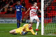 Doncaster Rovers forward Mallik Wilks (7), on loan from Leeds United (not shown) scores past Southend United goalkeeper Nathan Bishop (13) to score a goal and make the score 2-0 during the EFL Sky Bet League 1 match between Doncaster Rovers and Southend United at the Keepmoat Stadium, Doncaster, England on 12 February 2019.
