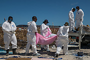 Personnel from the Royal Bahamas Police Force remove bodies recovered in a destroyed neighbourhood in the wake of Hurricane Dorian in Marsh Harbour, Great Abaco, Bahamas, September 9, 2019.