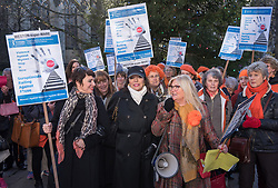 © Licensed to London News Pictures.  25/11/2017; Bristol, UK. Dame JOAN COLLINS and her daughter TARA NEWLEY ARKLE (with print scarf) with women's group The Soroptomists on Bristol's College Green at a rally against domestic violence and to campaign for healthy relationships. Under the banner 'Railing Against Abuse', members of the group travelled to Bristol by train on Saturday, November 25, before walking to College Green where they handed out leaflets entitled Loves Me, Loves Me Not in the shape of bookmarks and cards which offer a simple message about abusive relationships and a helpline for anyone who needs support. They were joined by Lord Mayor Lesley Alexander, and Avon & Somerset Police and Crime Commissioner Sue Mountstevens. The march marks the United Nations' Elimination of Violence Against Women Day. Picture credit: Simon Chapman/LNP