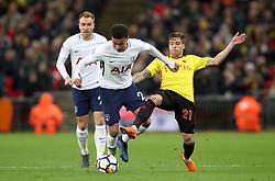 Tottenham Hotspur's Dele Alli (left) and Watford's Kiko Femenia battle for the ball during the Premier League match at Wembley Stadium. London.