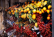 Lemons, cherries, and more fruits are stocked fresh at this fruit stand in Ponza, Italy
