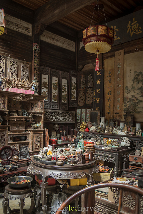 Interior of shop with lots of antiques, Xidi village, UNESCO World heritage, Anhui province, China