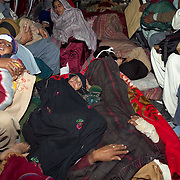 Injured earthquake survivors on-board a U.S. Army helicopter on their way from Muzzafarabad to Islamabad for medical treatment.