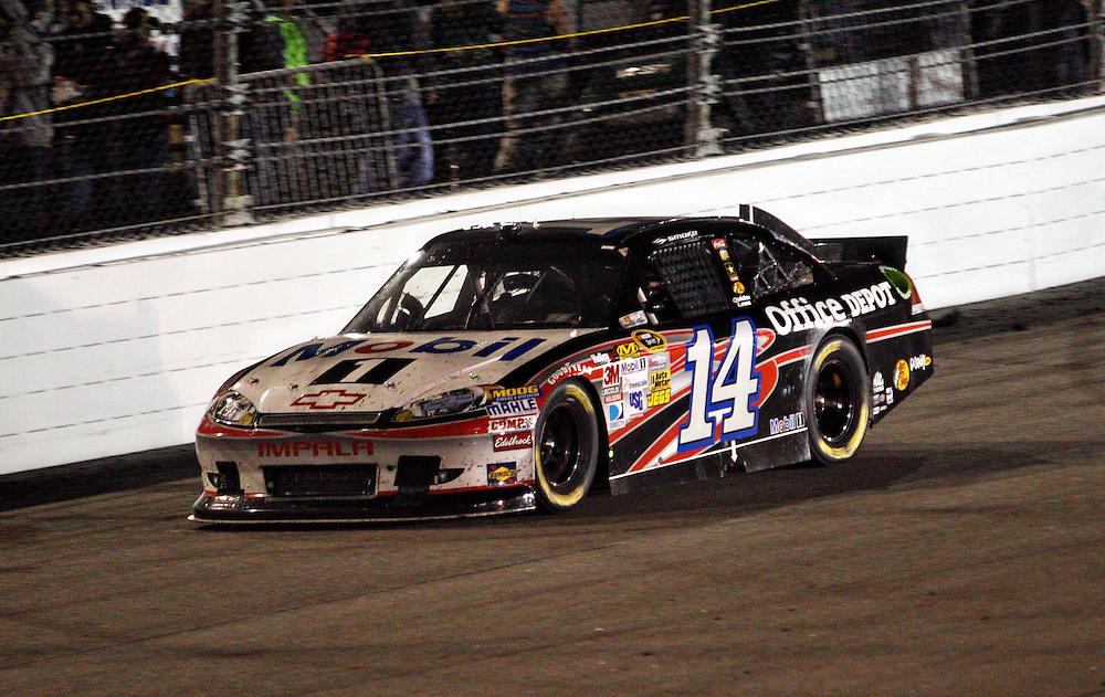 Apr 28, 2012; Richmond, VA, USA; NASCAR Sprint Cup driver Tony Stewart (14) during the Capital City 400 at Richmond International Raceway. Mandatory Credit: Peter Casey-US PRESSWIRE.