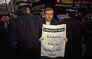 A Gay rights protester is arrested by Met Police officers while still carrying an Equality Now! sheet from the campaigning group Outrage!, on 6th February 1992, in London, England.