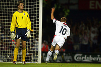 Photograph: Scott Heavey.<br />England  v Croatia, international. From Portman Road. 20/08.2003.<br />Michael Owen leaves Stipe Pletikosa helpless after firing a header passed him.