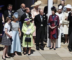 Members of the Royal family gather to watch as Prince Harry and Meghan Markle ride in an open-topped carriage through Windsor Castle after their wedding in St George's Chapel.