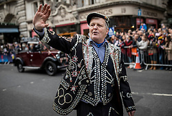 © Licensed to London News Pictures. 01/01/2019. London, UK. A member of the Pearly Kings and Queens waves to the crowd during the London New Year's Day Parade. More than 8,000 performers from 26 countries are taking part in the parade. Photo credit: Rob Pinney/LNP