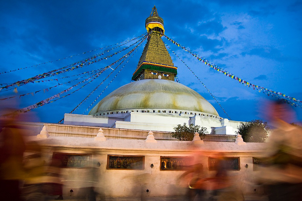 Crowds of worshipers endlessly swirl around the base of Boudhanath Stupa, Kathmandu, Nepal.