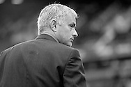 note : image converted into black & white. Jose Mourinho, the Chelsea manager looks on before k/o. Barclays Premier League, West Ham Utd v Chelsea at The Boleyn Ground, Upton Park in London on Saturday 24th October 2015.<br /> pic by John Patrick Fletcher, Andrew Orchard sports photography.