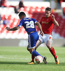 Nico Yennaris of Brentford (L) and Chris Cohen of Nottingham Forest in action - Mandatory by-line: Jack Phillips/JMP - 02/04/2016 - FOOTBALL - City Ground - Nottingham, England - Nottingham Forest v Brentford - Sky Bet Championship