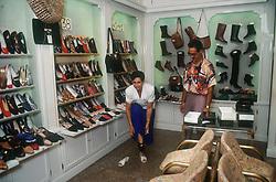 Customer trying on shoes in shoe shop; Gerona Girona,