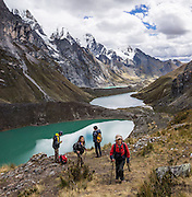 Quesillococha (a green lake at 4332 m), Lake Siula, and Lake Gangrajanca lie at the feet of massive peaks in the Cordillera Huayhuash, Andes Mountains, Peru, South America. This photo is at viewpoint halfway up the pass of Siula Punta. Day 3 of 9 days trekking around the Cordillera Huayhuash. This panorama was stitched from 3 overlapping photos.