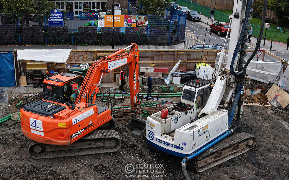 London, United Kingdom - 10 October 2015<br /> Huge drill cuts Virgin fiber cable. Thousand customers without weekend TV and internet. Severed fiber optic cables have caused up to a thousand customers of Virgin Media in Shoreditch and Hackney in London to be left without broadband internet and cable television this weekend. Engineers believe the total loss of service, which continues to be down this Saturday evening, is unlikely to be fixed until Sunday lunchtime at the earliest. The damage to a primary cable carrying 96 fiber optic cables including some belonging to the EE mobile network was caused by a huge drilling rig on a nearby construction site for a block of flats being built by Formation Construction Ltd. An engineer working on the drilling site claimed they had not 'drilled through the cable'. 'We damaged the cable' he said. He then demanded we delete images of the offending drilling rig. Technicians working on behalf of Virgin Media were working hard to replace the damaged cables. Virgin Media press office did not respond to repeated requests to speak with them for comment today.<br /> (photo by: EQUINOXFEATURES.COM)<br /> <br /> Picture Data:<br /> Photographer: Equinox Features<br /> Copyright: ©2015 Equinox Licensing Ltd. +448700 780000<br /> Contact: Equinox Features<br /> Date Taken: 20151010<br /> Time Taken: 18043711<br /> www.newspics.com